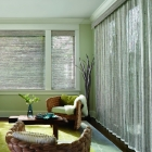 Vertical drapery made from woven wood materials adds texture to any room.