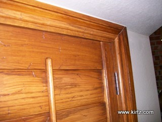 stained, distressed red oak shutters