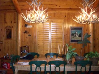 Knotty Pine interior shutters compliment this rustic ranch home