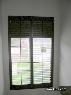 Shutters on almost 10' tall window