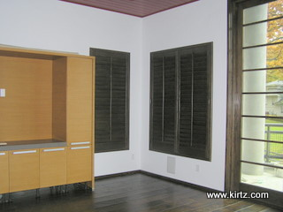 Dark plantation shutters pop in this visually clean space