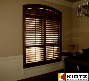 stained oak shutters with painted casing